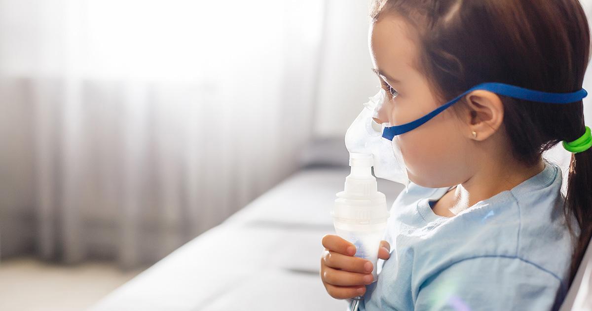 Little girl using a nebulizer