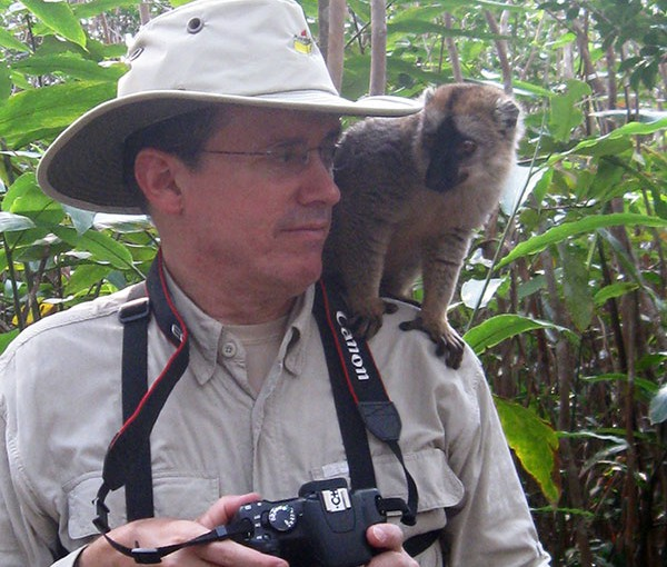 Getting a little advice on nature photography from a local while traveling in Madagascar